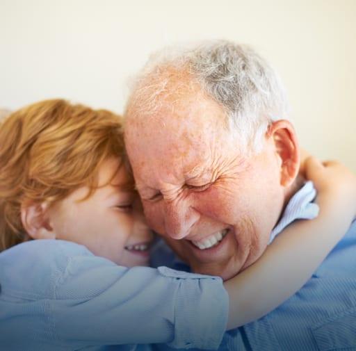 Child Hugging Elderly Man