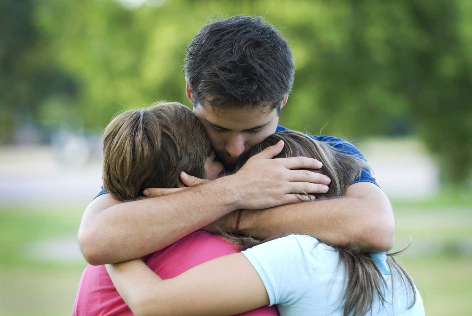 Father Consoling Children Stock Photo