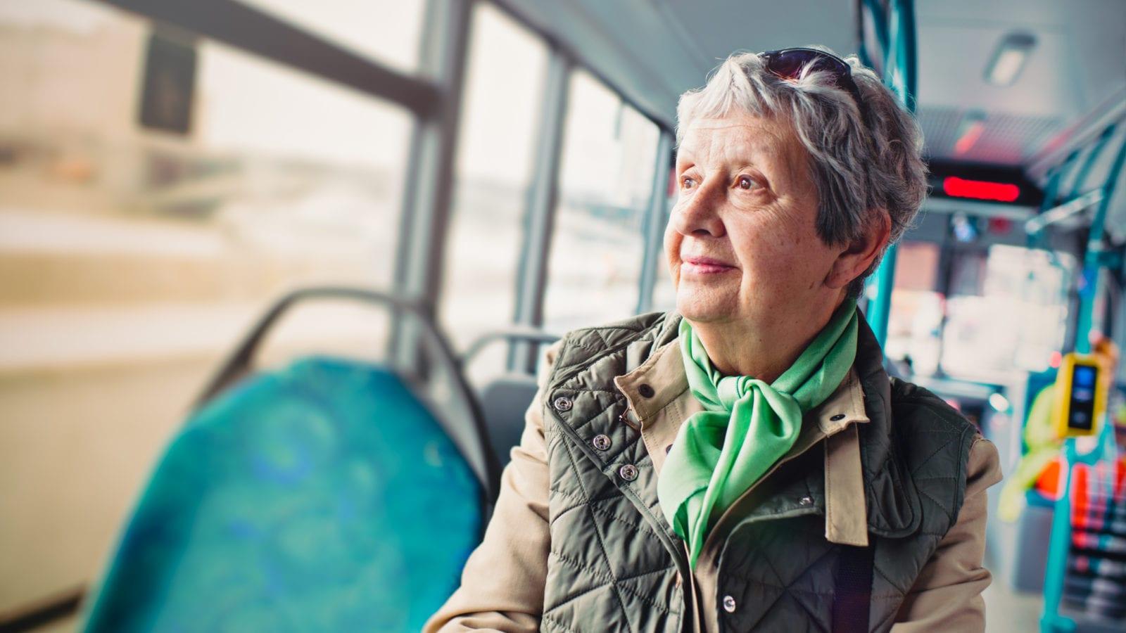 Senior Woman On The Bus Stock Photo