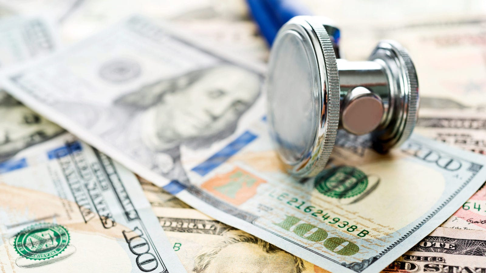 Stethoscope and Dollar Bills Stock Photo