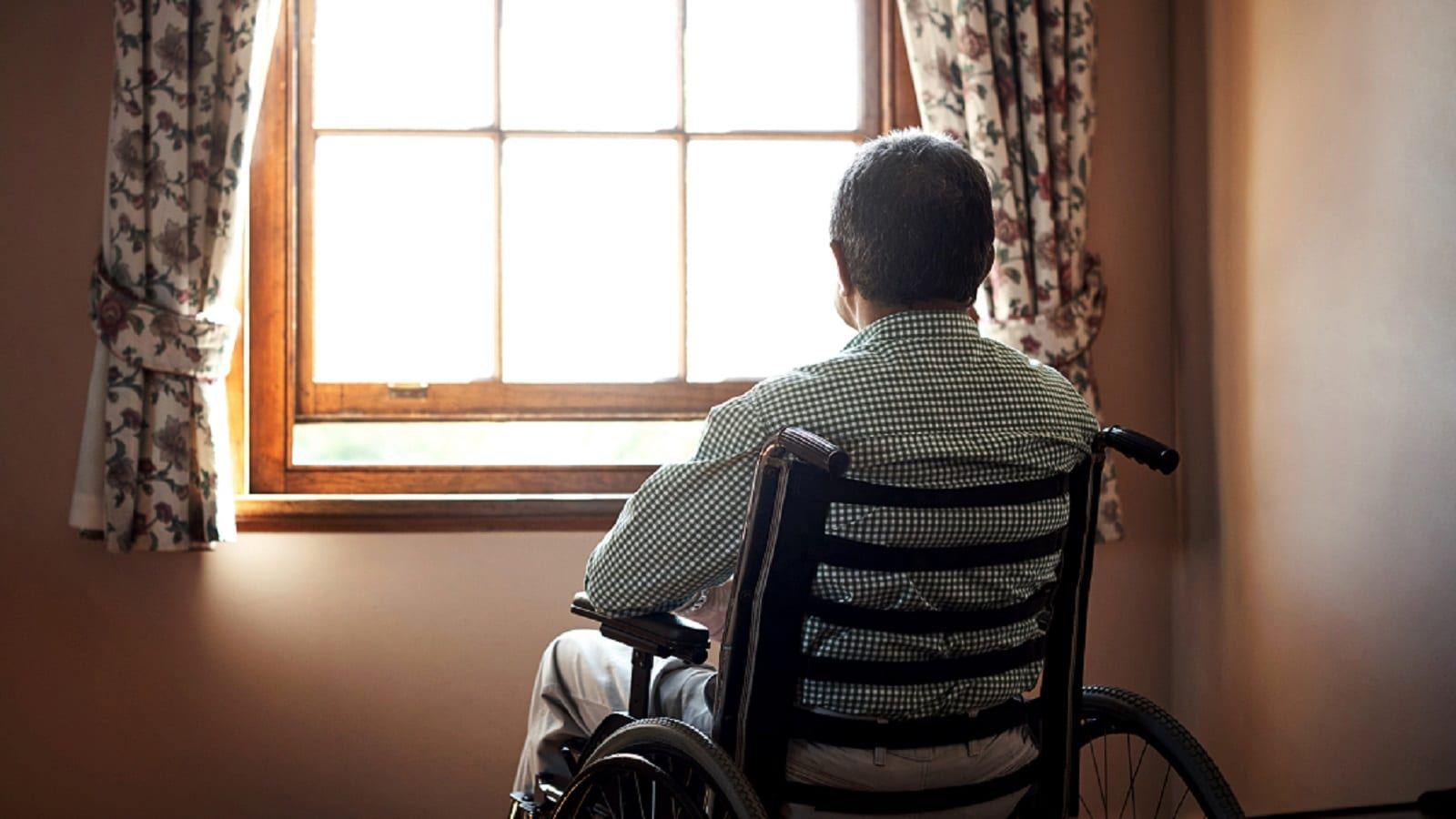 Elderly Man Sitting In Wheelchair Stock Photo