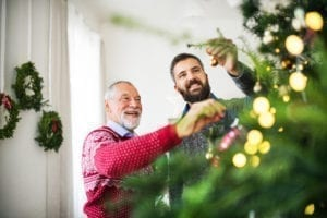 father-and-son-decorating-christmas-tree