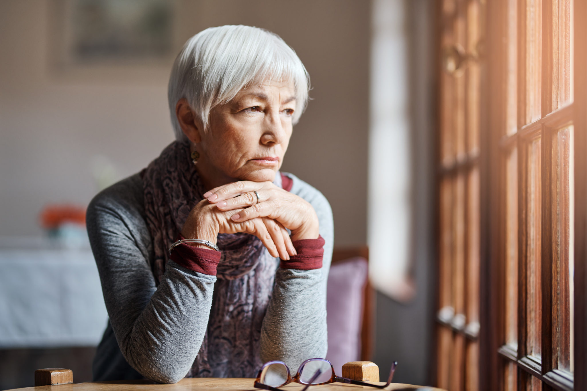 Shot of a senior woman looking thoughtful in a retirement home