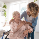 Happy Nursing Home Resident With Her Caregiver