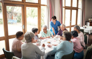 Nursing Home Residents Playing Cards At A Table