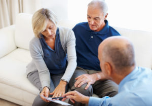 older couple meeting with their Long-Term Care Ombudsman