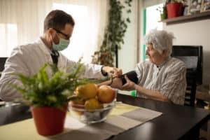 doctor providing care to a nursing home resident