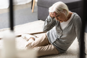 a senior woman after experiencing a fall due to neglect