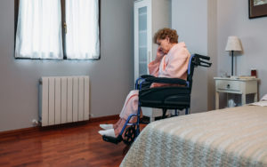 a senior woman experiencing isolation in her Charleston, WV, nursing home facility