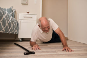 an elderly man who suffered a fall due to neglect in his nursing home