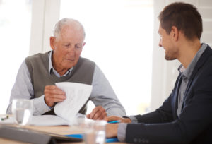 a man reviewing his nursing home agreement paperwork in Charleston, WV