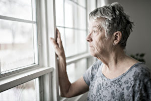 A lonely elderly woman suffering neglect in her Charleston, WV, nursing home.