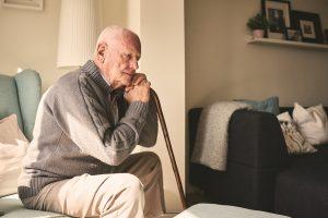 An elderly man sitting alone in his Charleston, WV, nursing home.
