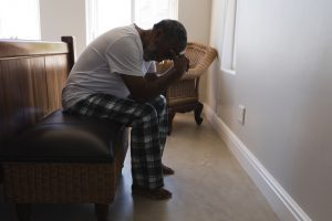 An elderly man in Charleston, WV, looking distraught after suffering elder abuse.