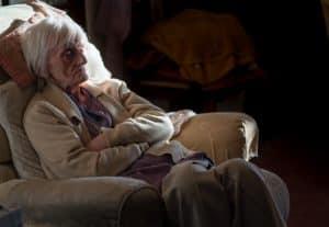 A elderly woman after suffering elder neglect.